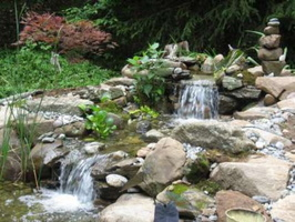 Small-waterfall-with-stones-for-natural-water-garden