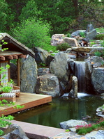 landscape-design-ideas-natural-stones-waterfall-wooden-deck-outdoor-furniture