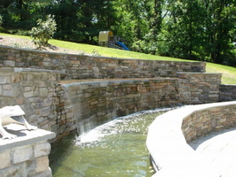 water-fixtures-waterfalls-landscaping-company-retaining-waterfall-wall-backyard-decoration-images-wall-waterfall-976x732